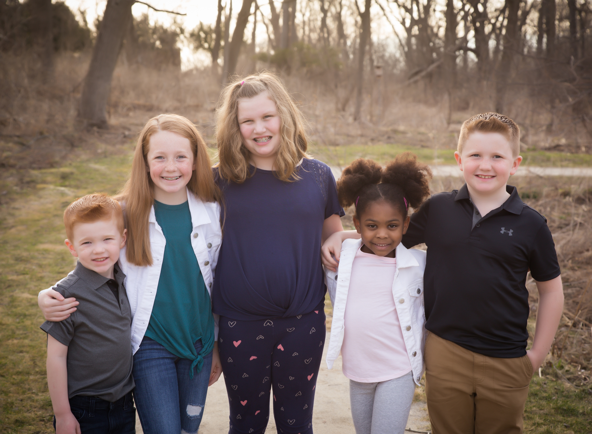 image-of-5-smiling-cousins-with-their-arms-around-eachother
