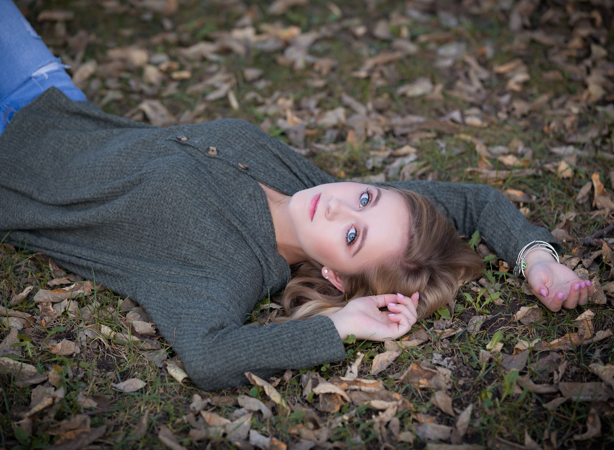 serious-senior-girl-laying-down